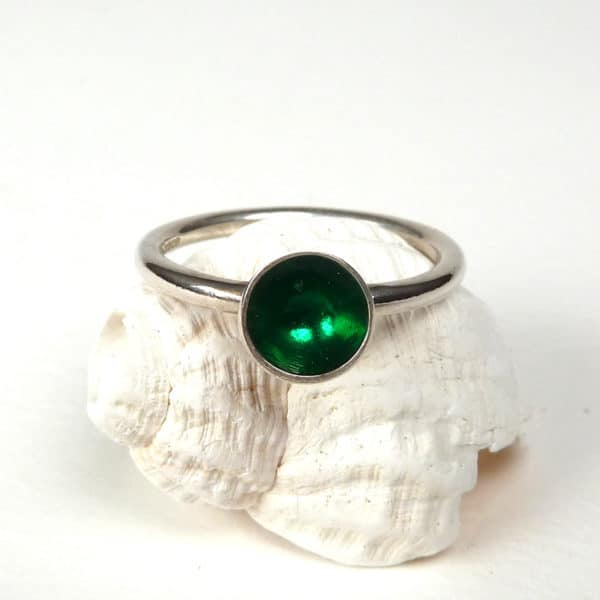 Emerald green and silver ring