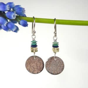 Silver and gemstone earrings.